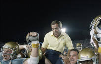 FILE - In this Sept. 10, 1988, file photo, UCLA coach Terry Donahue is carried off the field by his players after UCLA defeated Nebraska, 41-28 at the Rose Bowl in Pasadena, Calif. The victory was Donahue's 100th as Bruin coach. Donahue, the winningest coach in Pac-12 Conference and UCLA football history who later served as general manager of the NFLs San Francisco 49ers, died Sunday, July 4, 2021. He was 77. (AP Photo/Reed Saxon, File)