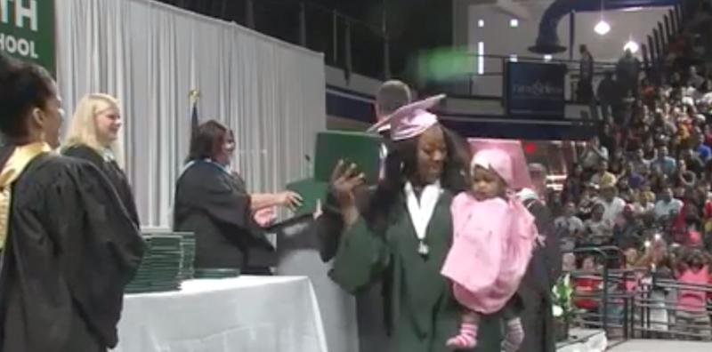 Two teen mothers happily accepted their high school diplomas in Iowa to set examples for their young daughters. (Photo: KCCI)