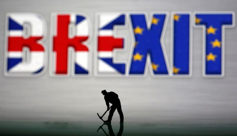 FILE PHOTO: A small toy figure is seen in front of a Brexit logo in this illustration picture