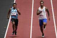Adrian Ililau, of Palau, and Scott Fiti, of Federated States of Micronesia, compete in a heat in the men's 100-meter run at the 2020 Summer Olympics, Saturday, July 31, 2021, in Tokyo. (AP Photo/Charlie Riedel)