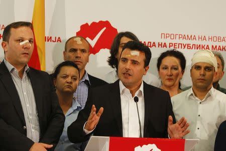Macedonian Social Democratic leader Zoran Zaev (C) and members of his party attend a news conference in Skopje, Macedonia, April 28, 2017. REUTERS/Ognen Teofilovski