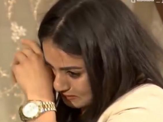 Yazidi woman Ashraq Haji Hamid is unable to hold back the tears as she questions the man who bought her as a sex slave (Iraqi Media Network)