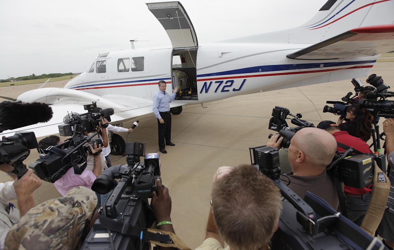 Mike Stuart of Dynamic Aviation describes a plane that will be used for aerial spraying to the media in Dallas, Thursday, Aug. 16, 2012. The last time Dallas used aerial spraying to curb the mosquito population, Texas' Lyndon Johnson was in the White House, Mission Control in Houston was launching Gemini missions and encephalitis was blamed for more than a dozen deaths. But for the first time in more than 45 years, the city and county planned Thursday to resume dropping insecticide from the air to combat the nation's worst outbreak of West Nile virus, which has killed 10 people and caused at least 200 others to fall ill. (AP Photo/LM Otero)