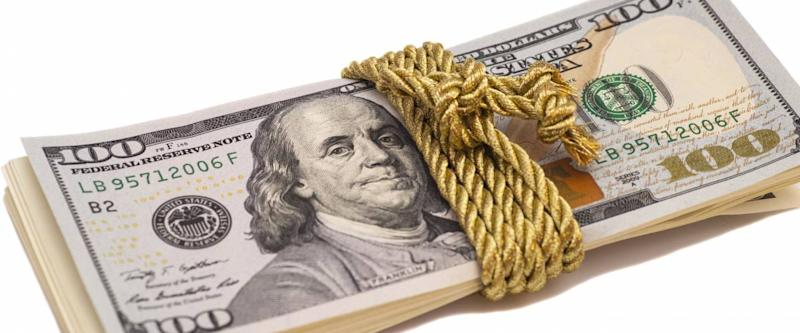 hundred dollar banknotes with golden rope band, isolated on white background
