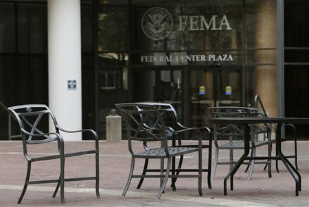 Empty tables and chairs are seen outside the main headquarters of FEMA, which is partially closed, during day three of the U.S. government shutdown in Washington October 3, 2013. REUTERS/Gary Cameron