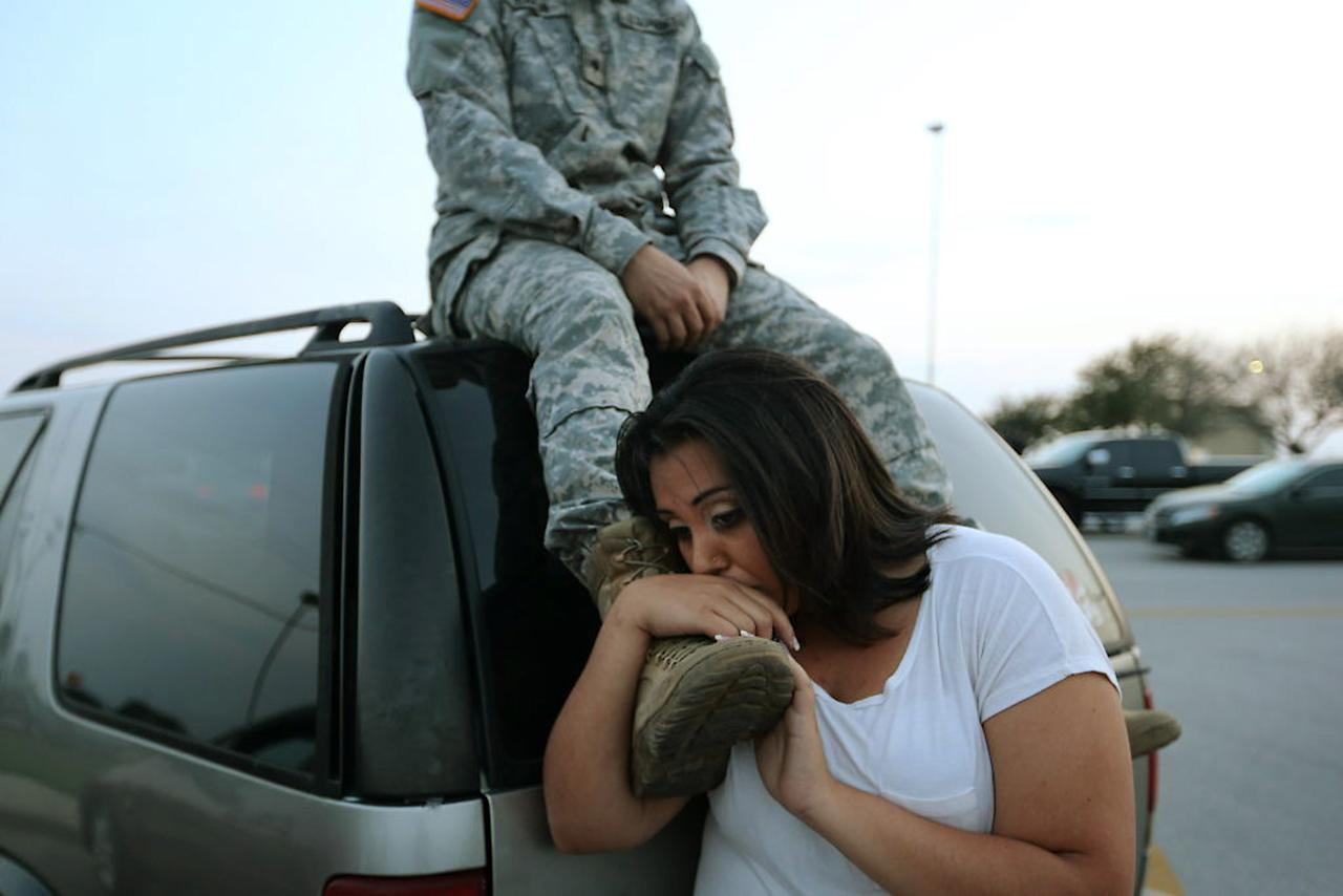 Luci Hamlin and her husband Specialist Timothy Hamlin wait to get back to their home on base at Fort Hood, Texas, April 2, 2014. Several people were killed and at least 14 injured on Wednesday when a gunman opened fire at a U.S. Army base in Fort Hood, Texas, the site of another rampage in 2009, U.S. officials said. REUTERS/Austin American-Statesman/Deborah Cannon (UNITED STATES - Tags: CRIME LAW MILITARY TPX IMAGES OF THE DAY) NO SALES. NO ARCHIVES. FOR EDITORIAL USE ONLY. NOT FOR SALE FOR MARKETING OR ADVERTISING CAMPAIGNS. MANDATORY CREDIT