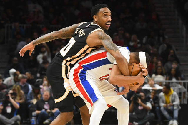 Atlanta Hawks guard Jeff Teague, left, becomes entangled with Detroit Pistons guard Tim Frazier as a jump ball is called during the second half of an NBA basketball game Saturday, Jan. 18, 2020, in Atlanta. (AP Photo/John Amis)
