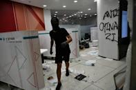 Protesters damaged property after breaking into a branch of the Bank of China in the Tseung Kwan O residential neighbourhood of Kowloon
