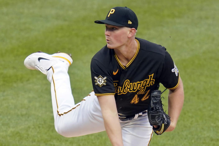 Pittsburgh Pirates starting pitcher Mitch Keller follows through with a pitch against the San Diego Padres during the first inning of a baseball game, Thursday, April 15, 2021, in Pittsburgh. (AP Photo/Keith Srakocic)