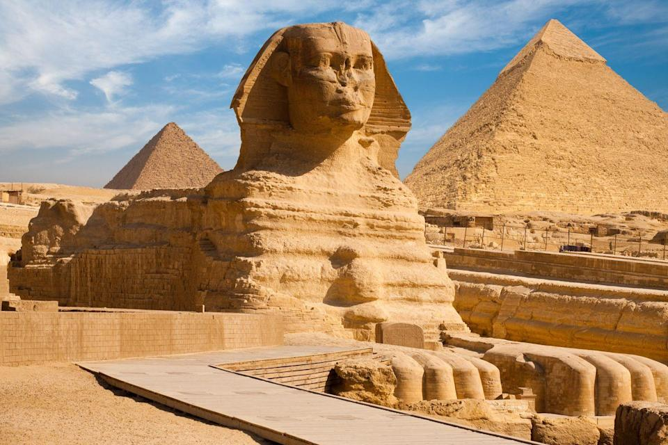 "<p>The <a href=""https://www.smithsonianmag.com/history/ancient-egypt-shipping-mining-farming-economy-pyramids-180956619/"" rel=""nofollow noopener"" target=""_blank"" data-ylk=""slk:monumental pyramids"" class=""link rapid-noclick-resp"">monumental pyramids</a> of Giza stand as a reminder of the ancient Egyptians' innovative thinking and engineering. These tombs, filled with the belongings of Egypt's pharaohs, were erected to help guide the leaders into the afterlife. </p><p>Pharaoh Khufu began the first and largest Giza pyramid around 2550 B.C., which is thought to be made of 2.3 million stone blocks. Khufu's son, Pharaoh Khafre, not only built the second pyramid, but also the Sphinx, whose face is said to resemble the pharaoh's. The last and smallest tomb for Pharaoh Menkaure features a complex mortuary temple with elaborate paintings and inscriptions.</p>"