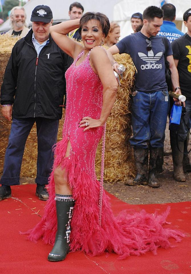 <p>Dame Shirley Bassey proving age is nothing but a number as she poses backstage at Glastonbury on a red carpet, in wellies and a feathered evening gown.</p>