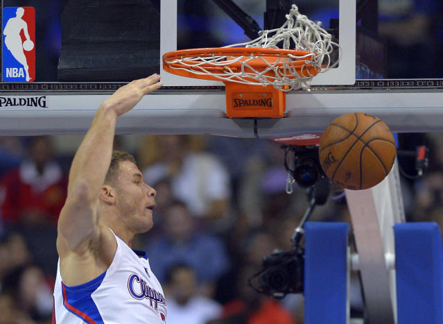 Los Angeles Clippers forward Blake Griffin dunks during the first half of an NBA basketball game against the Utah Jazz, Saturday, Dec. 28, 2013, in Los Angeles. (AP Photo/Mark J. Terrill)