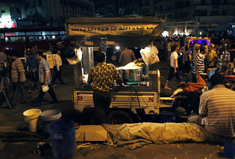 An Egyptian street vendor waits for customers during a Muslim Brotherhood's anti-ruling military council demonstration in Tahrir Square, Cairo, Egypt Wednesday, June 20, 2012. Authorities delayed Thursday's planned announcement of the winner of Egypt's presidential election, likely for several days, hiking tension as allegations of fraud swirled and each candidate declared he was the victor. (AP Photo/Nasser Nasser)