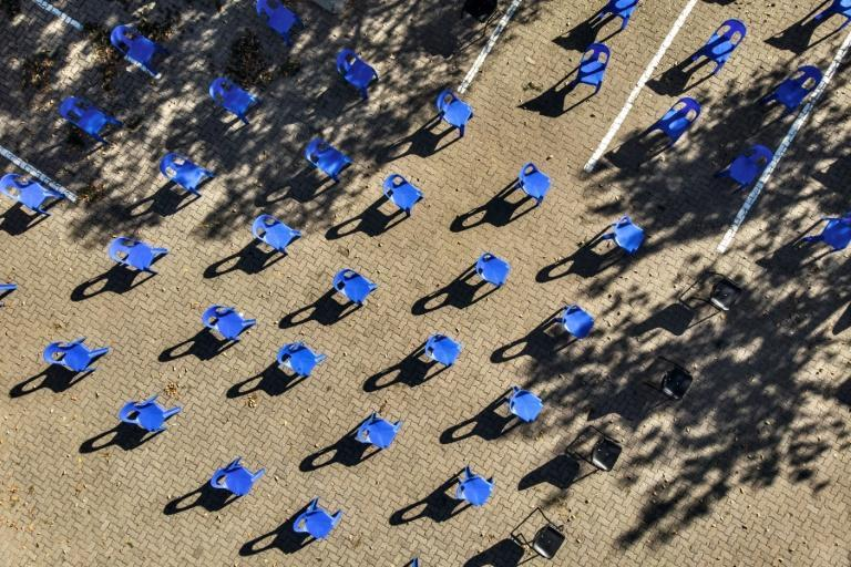 Aerial view of chairs arranged in order to maintain social distancing at a parking lot in Soweto for food distribution (AFP Photo/MARCO LONGARI)
