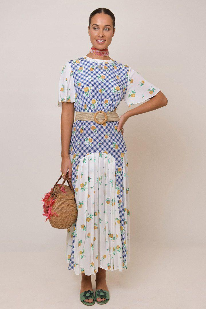 "<p><a class=""link rapid-noclick-resp"" href=""https://rixo.co.uk/collections/dresses/products/jennifer-gingham-rose-mix-navy-cream"" rel=""nofollow noopener"" target=""_blank"" data-ylk=""slk:SHOP NOW"">SHOP NOW</a></p>"