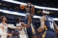 New Orleans Pelicans forward Zion Williamson (1) is fouled by Memphis Grizzlies guard Josh Jackson during the first half of an NBA basketball game in New Orleans, Friday, Jan. 31, 2020. (AP Photo/Gerald Herbert)