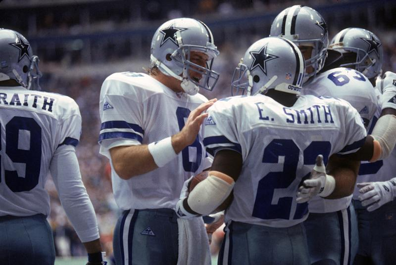 Running back Emmitt Smith (22) and quarterback Troy Aikman (8) helped lead the Cowboys to three Super Bowls in four years. (Photo by James Smith/Getty Images)