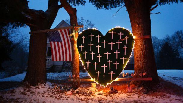 PHOTO: A memorial with crosses for the victims of the Sandy Hook Elementary School shooting massacre stands outside a home in Newtown, Conn., on the one-year anniversary of the shootings, Dec. 14, 2013. (Robert F. Bukaty/AP, FILE)