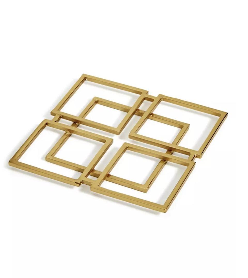 <p>This <span>Hotel Collection Modern Trivet</span> ($23, originally $39) will bring a distinctively elegant touch to your table.</p>