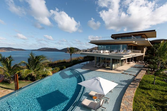 The Oasis estate sits perched on one of the island's highest points, overlooking the sparkling sea below.