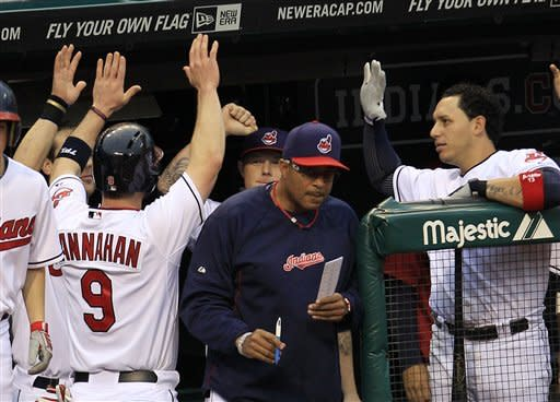 Cleveland Indians' Jack Hannahan is congratulated by teammates after hitting a solo home run off Texas Rangers' Colby Lewis in the third inning in a baseball game, Friday, May 4, 2012, in Cleveland. (AP Photo/Tony Dejak)