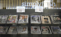 FILE - In this file photo dated Saturday, April 10, 2021, the front pages with photos of Britain's Prince Philip at a newsstand in London. Britain's Prince Philip, the irascible and tough-minded husband of Queen Elizabeth II who spent more than seven decades supporting his wife in a role that mostly defined his life, died on Friday. Prince Philip who died Friday April 9, 2021, aged 99, lived through a tumultuous century of war and upheavals that are recorded in the pages of newspapers every day across the world. (AP Photo/Alberto Pezzali, FILE)