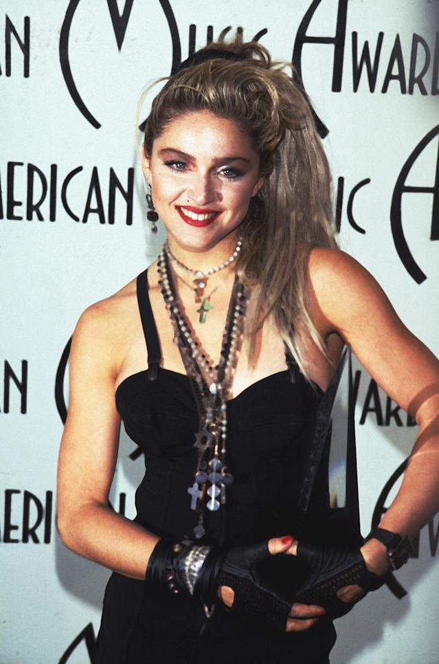 <p>Madonna certainly stood out from the crown in this get-up; wearing layered necklaces, crucifixes, black gloves and a black corset, the singer looked edgy, sultry and bada**. <em>[Photo: Getty]</em> </p>