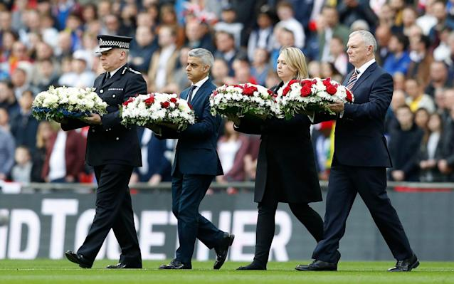<span>London Mayor Sadiq Khan lays a wreath on the pitch as respect for the victims of the London attack</span> <span>Credit: Reuters </span>