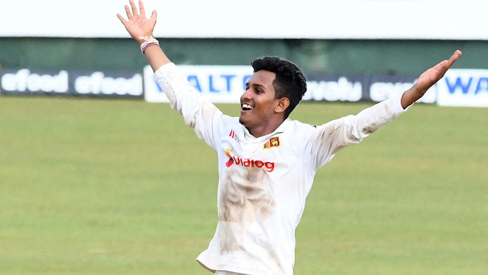 Pictured here, Sri Lankan spinner Praveen Jayawickrama celebrates in the second Test against Bangladesh.