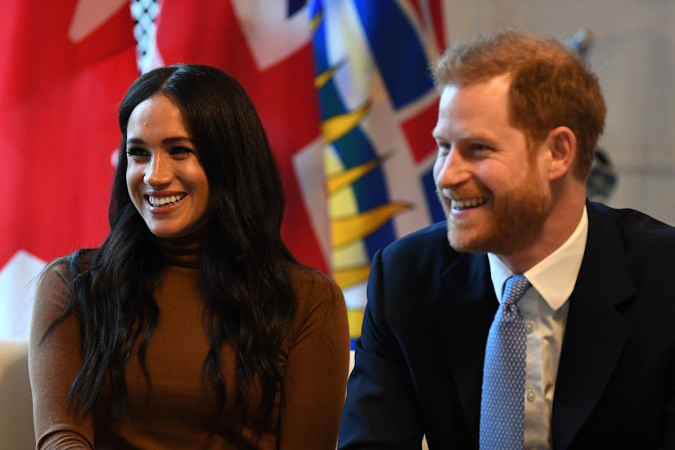 Britain's Prince Harry, Duke of Sussex and Meghan, Duchess of Sussex gesture during their visit to Canada House