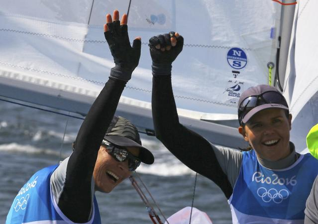 2016 Rio Olympics - Sailing - Final - Women's Two Person Dinghy - 470 - Medal Race - Marina de Gloria - Rio de Janeiro, Brazil - 18/08/2016. Jo Aleh (NZL) of New Zealand and Polly Powrie (NZL) of New Zealand celebrate winning silver medal. REUTERS/Brian Snyder FOR EDITORIAL USE ONLY. NOT FOR SALE FOR MARKETING OR ADVERTISING CAMPAIGNS.