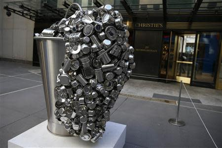"""Spill"", a stainless steel vessel by Subodh Gupta is seen on display during ''The Spring 2-14 Sales of Asian Art Week"" media preview at Christie's Auction House in New York"