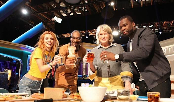 """50 Cent and Bella Thorne with Martha Stewart and Snoop Dogg on the season finale of """"Martha Snoops Potluck Dinner Party,"""" which aired 3/6 on VH1."""