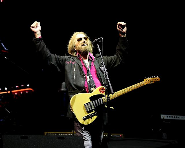 "<p>On Oct. 2, the iconic rocker and Heartbreakers frontman died, after being <a href=""https://www.yahoo.com/music/tom-petty-dies-rock-legend-040855489.html"" data-ylk=""slk:found unconscious;outcm:mb_qualified_link;_E:mb_qualified_link"" class=""link rapid-noclick-resp newsroom-embed-article"">found unconscious</a> and in cardiac arrest at his home in Malibu, Calif. It was a loss that left the music world reeling. The Rock and Roll Hall of Famer, whose many hits include ""I Won't Back Down,"" ""Free Fallin',"" and ""Learning to Fly,"" was 66. ""It's shocking, crushing news,"" Bob Dylan, Petty's bandmate in the Traveling Wilburys, said in a statement to <a href=""https://www.rollingstone.com/music/news/tom-petty-rock-iconoclast-who-led-the-heartbreakers-dead-at-66-w506651"" rel=""nofollow noopener"" target=""_blank"" data-ylk=""slk:Rolling Stone"" class=""link rapid-noclick-resp""><i>Rolling Stone</i></a>. ""I thought the world of Tom. He was a great performer, full of the light, a friend, and I'll never forget him."" (Photo: Getty Images) </p>"