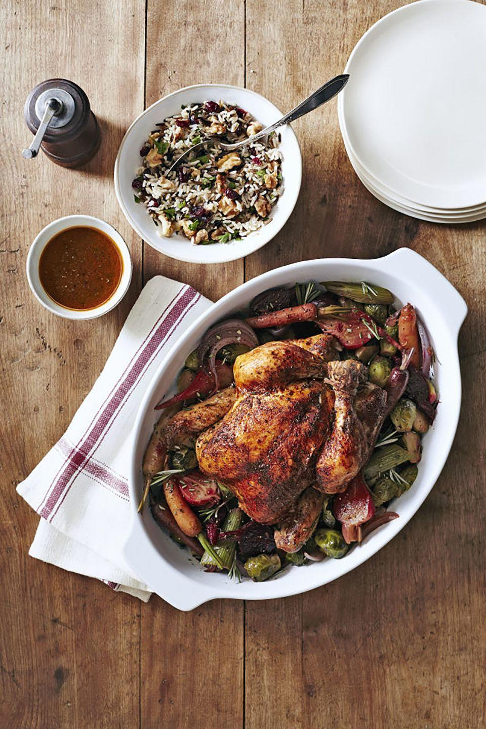 """<p>Technically a chicken recipe, this will also work with a smaller, 8-9 pound turkey. If you like crispy skin, you can just broil it for 10-15 minutes in the oven right at the end.</p><p><strong><a href=""""https://www.countryliving.com/food-drinks/recipes/a5689/herbed-chicken-beets-brussels-recipe-clx1014/"""" rel=""""nofollow noopener"""" target=""""_blank"""" data-ylk=""""slk:Get the recipe"""" class=""""link rapid-noclick-resp"""">Get the recipe</a>.</strong> </p>"""