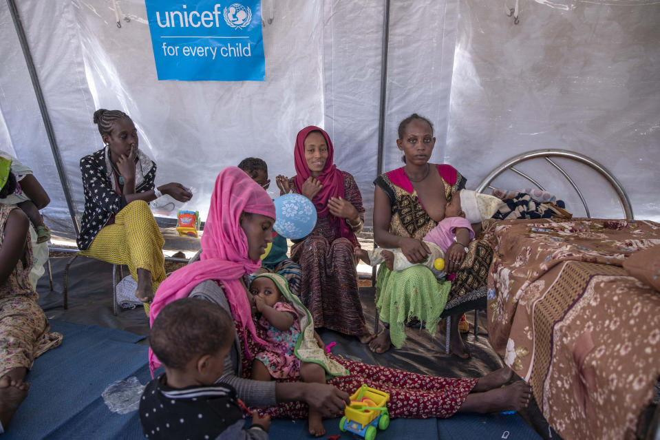 Women sit with their breastfeed their children as Filippo Grandi, U.N. High Commissioner for Refugees, visits Umm Rakouba refugee camp sheltering people who fled the conflict in Ethiopia's Tigray region in Qadarif, eastern Sudan, Saturday, Nov. 28, 2020. (AP Photo/Nariman El-Mofty)