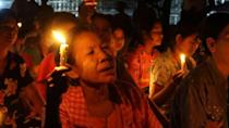 Myanmar township residents march with candles to honour those killed