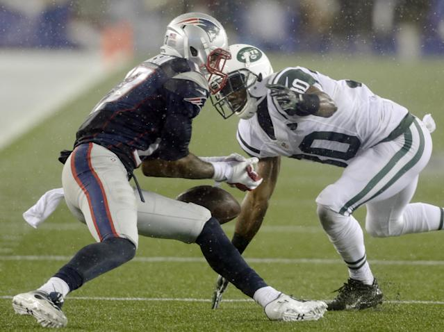 New England Patriots wide receiver Aaron Dobson (17) drops a pass in front of New York Jets cornerback Darrin Walls (30) during the third quarter of an NFL football game Thursday, Sept. 12, 2013, in Foxborough, Mass. (AP Photo/Charles Krupa)