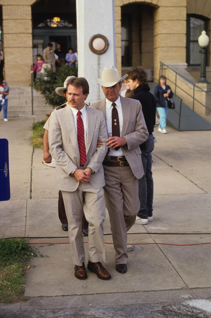 Michael Morton is led away from the Williamson County Courthouse on Feb. 17, 1987 after he was wrongfully convicted of murdering his wife, Christine Morton.