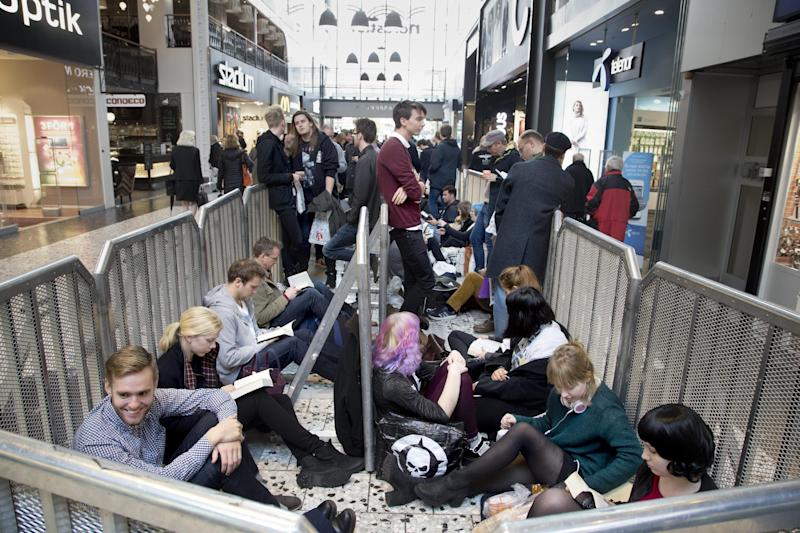 Fans of the music star and songwriter Morrisey waiting in line outside a bookshop in central Goteborg, Sweden, Thursday Oct. 17, 2013 to buy a signed copy of his autobiography. (AP Photo/TT, Bjorn Larsson Rosvall) SWEDEN OUT