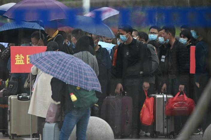Crowds swamped railway stations in Hubei as people took advantage of the chance to leave the province (AFP Photo/Noel Celis)