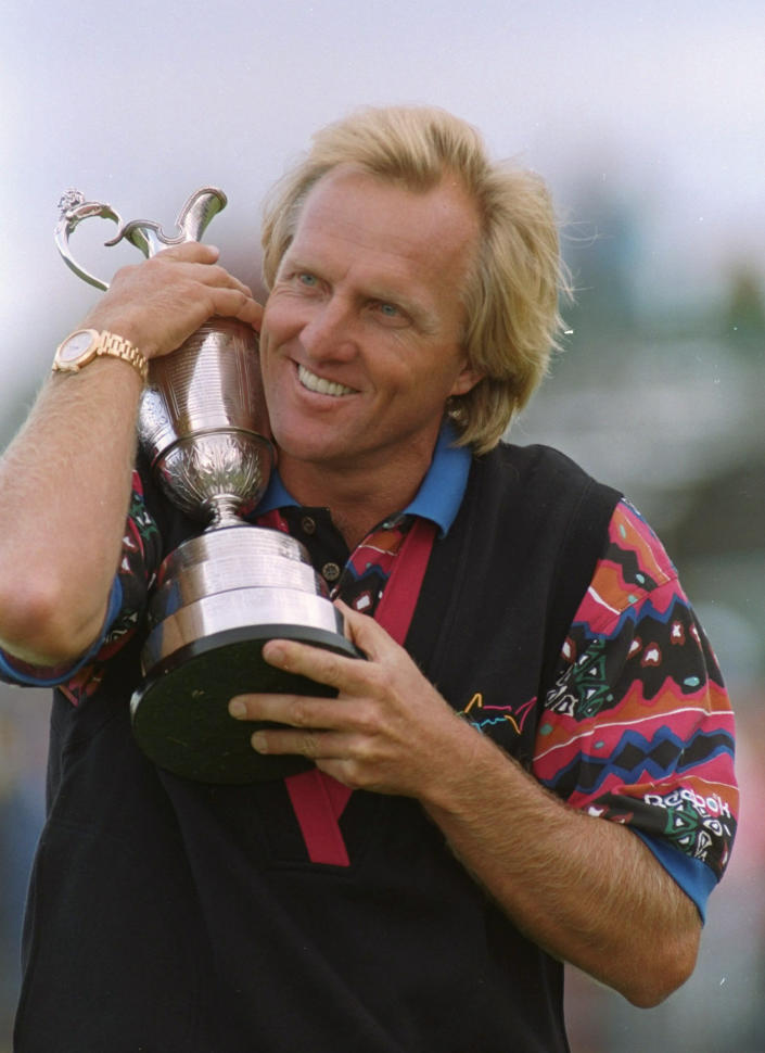 FILE - In this July 18, 1993, file photo, Australia's Greg Norman hugs the Claret Jug after winning the British Open Golf Championship at Royal St. Georges golf club in Sandwich, England. Norman has the lowest 72-hole score ever recorded at Royal St. George's, site of this year's British Open. (AP Photo/Michel Euler, File)