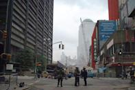 <p>The skeleton of one of the twin towers is seen as emergency personnel keep the area secure on Sept. 19, 2001. (Photo: Gordon Donovan/Yahoo News) </p>
