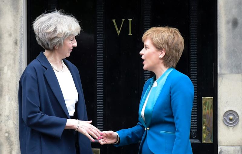 British Prime Minister Theresa May (left) is due to hold talks with Scottish First Minister Nicola Sturgeon to try to avert Scotland's new independence bid