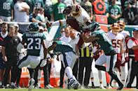 Tight end Vernon Davis #85 of the Washington Redskins leaps over defenders before rushing a reception for a touchdown against the Philadelphia Eagles during the first quarter at Lincoln Financial Field on September 8, 2019 in Philadelphia, Pennsylvania. (Photo by Patrick Smith/Getty Images)