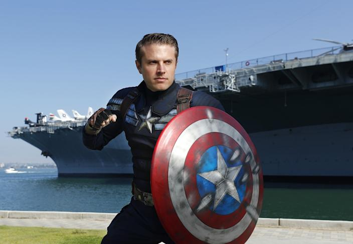 "Matt Mullis dressed in Captain America's Stealth Suit, from ""The Winter Soldier,"" near the USS Midway Museum in San Diego. Mullis has been to Comic-Con the last two year, and after ordering the suit made custom modifications with stars and stripes along with weathering it. The first time he went to Comic-Con, his outfit was well received at a Marvel cosplay contest. <span class=""copyright"">(K.C. Alfred / The San Diego Union-Tribune)</span>"