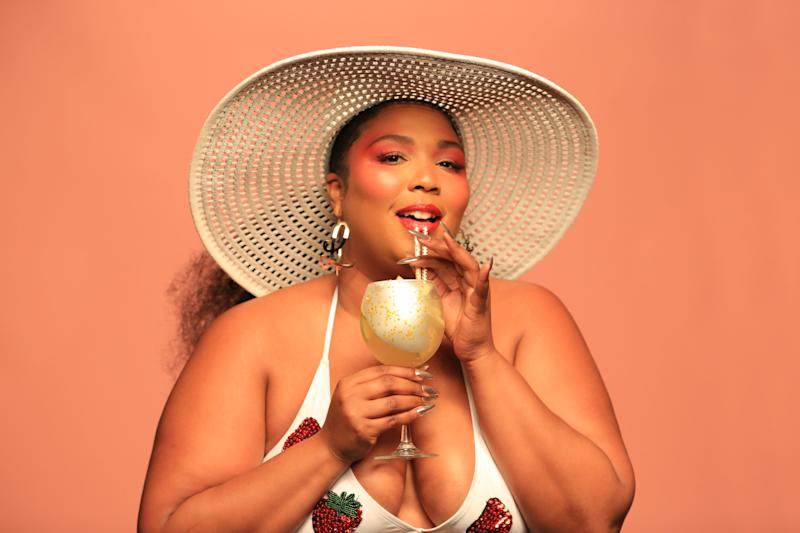 Lizzo is everywhere these days, even in alcohol ads. Here, she poses with an Absolut Juice drink.