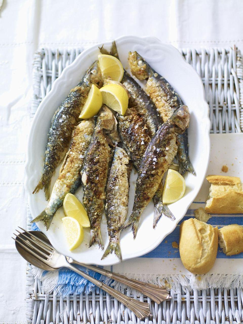 "<p>They may be small, but they're packed with omega-3s. Plus, <a href=""https://www.goodhousekeeping.com/health/diet-nutrition/g1967/vitamin-b12-super-foods-47012607/"" rel=""nofollow noopener"" target=""_blank"" data-ylk=""slk:sardines have less mercury than other fatty fish"" class=""link rapid-noclick-resp"">sardines have less mercury than other fatty fish</a> and come readily available in canned form. Just be sure to buy them packed in water, not oil.</p>"