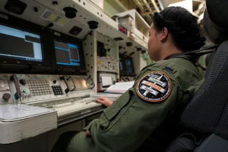 In preparation for an unarmed Minuteman III intercontinental ballistic missile launch, 1st Lt. Kimberly Erskine, Missile Combat Crew commander from Malmstrom Air Force Base, practices procedures at Vandenberg Air Force Base, California, U.S., March 19, 2015. Picture taken March 19, 2015. U.S. Air Force/Michael Peterson/Handout via REUTERS