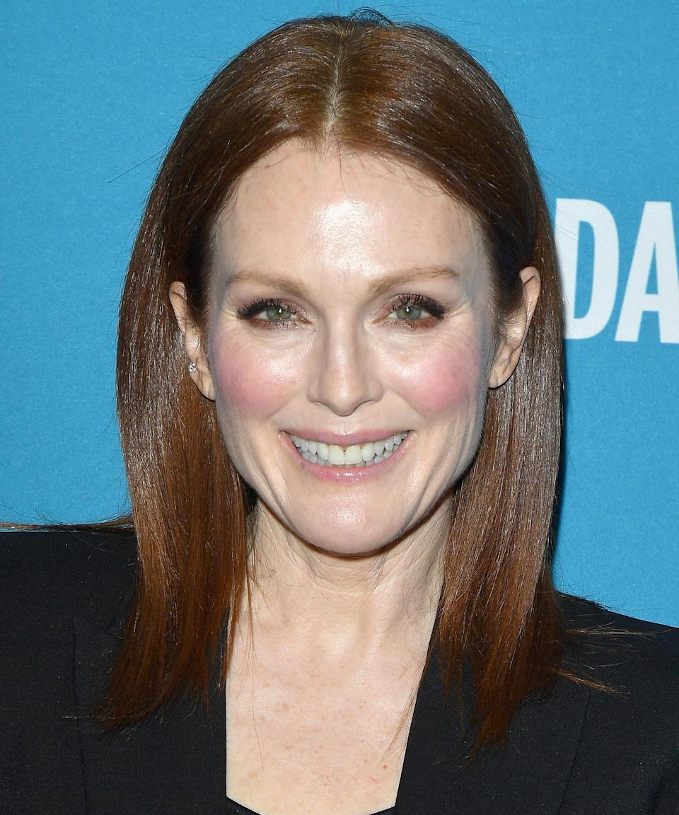 """<strong><h2>Julianne Moore</h2></strong>Moore has never confirmed whether or not her deep auburn hair color is natural or not, but if her daughter and mini-me <a href=""""https://people.com/movies/julianne-moore-brings-15-year-old-lookalike-daughter-as-her-date-to-new-york-fashion-week/"""" rel=""""nofollow noopener"""" target=""""_blank"""" data-ylk=""""slk:Liv Freundlich"""" class=""""link rapid-noclick-resp"""">Liv Freundlich</a> is any indication, that's the kind of color you just can't get out of a bottle.<span class=""""copyright"""">Photo: George Pimentel/Getty Images.</span>"""